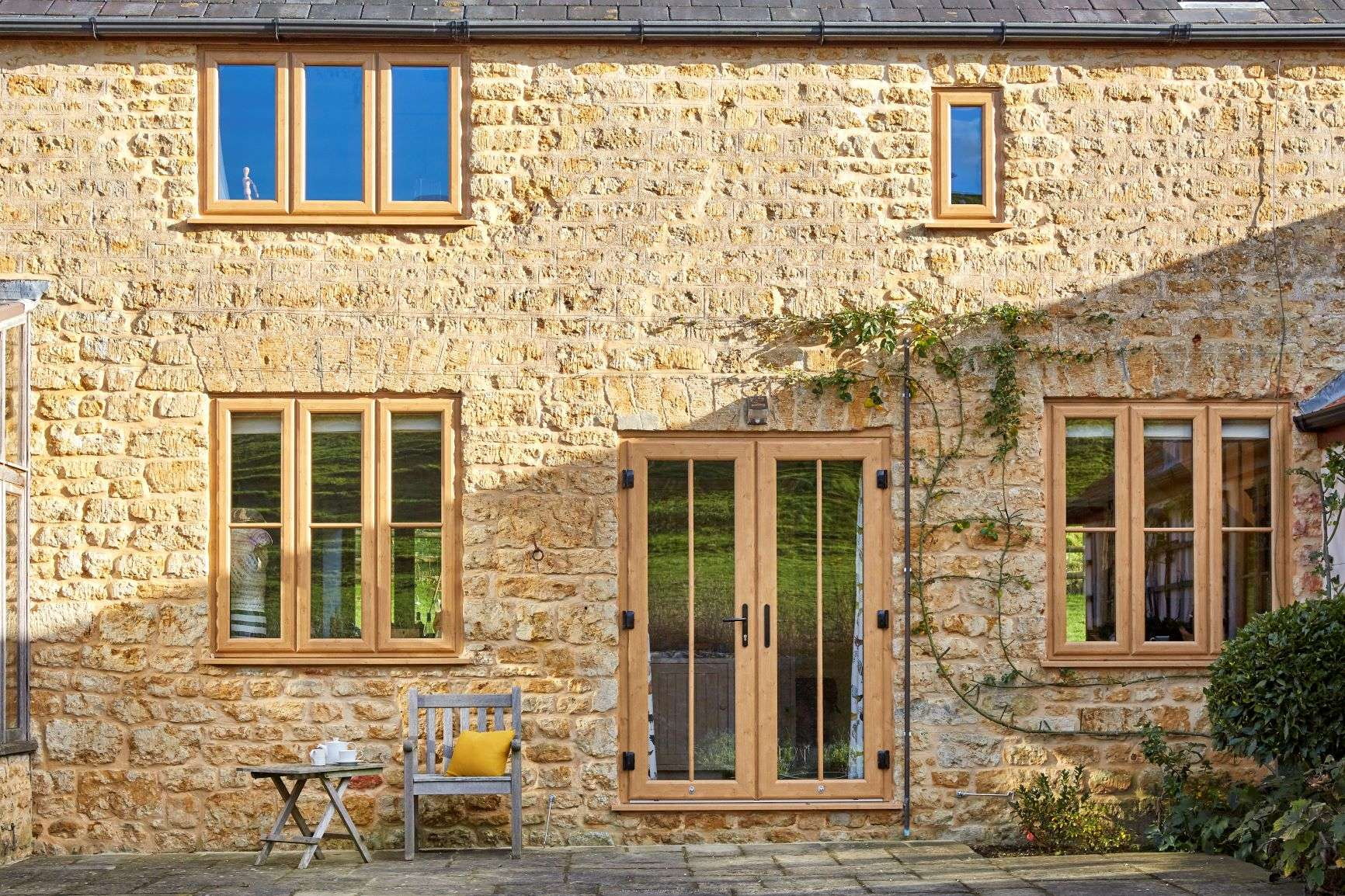 VEKA woodgrain French Doors on a traditional stone property