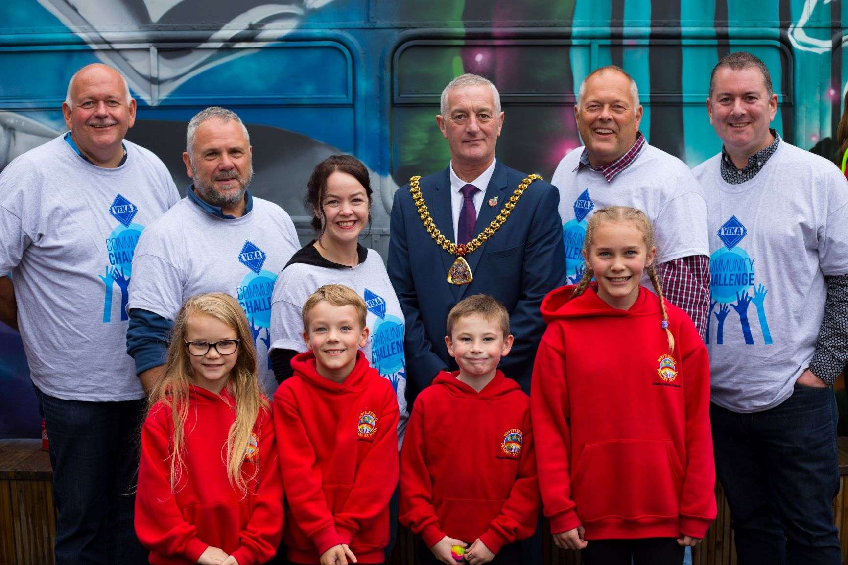 VEKA Directors, the Mayor and the children stood proudly next to the bus